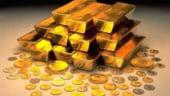 Pretul record al petrolului si deprecierea dolarului au scumpit aurul cu 1%