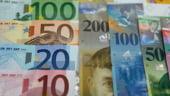 Banca centrala a Elvetiei promite sa mentina cursul la 1,20 franci/euro