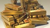 Curs valutar: Aurul a ajuns la cel mai inalt nivel din ultimii 7 ani