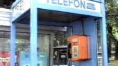 Telefonul public si fixul provoaca pierderi masive Romtelecomului