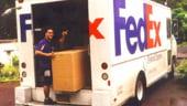 FedEx a afisat pierderi nete de 876 milioane dolari in al patrulea trimestru fiscal