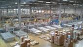 Peste 3.000 de magazine din Romania sunt aprovizionate zilnic cu produse din 23 de centre de distributie (analiza)