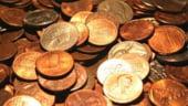 Aprecierea dolarului a ieftinit aurul pe pietele internationale