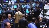 Bursa scadea usor dupa primele tranzactii