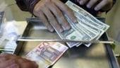 Dolarul atinge nivelul record de 1,5905 dolari/euro
