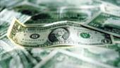Dolarul se depreciaza dupa ce Federal Reserve indica perspective sumbre asupra economiei