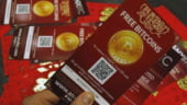 Moneda virtuala Bitcoin, atacata din toate partile. Hackerii si reglementatorii, principalii inamici