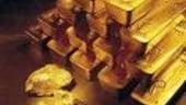 Pretul aurului scade dupa ce Bernanke a spus ca o majorare a dobazii cheie este posibila