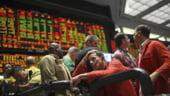 Bursele din SUA pierd castigurile anterioare si inchid pe rosu