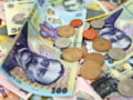 Moneda nationala se depreciaza in prima sedinta a anului