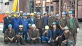 Numarul de muncitori straini in Romania a scazut cu 40%