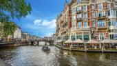 Amsterdam introduce o noua taxa pentru turisti, din care va aduna sute de milioane de euro