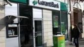 Garanti Bank estimeaza o scadere in trepte a ratei dobanzii de politica monetara
