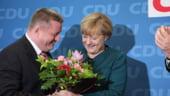 Merkel, iubita de imigrantii sirieni si huiduita acasa