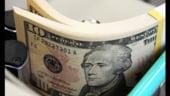 Marcarea profitului de catre investitori a apreciat dolarul cu 0,3% fata de un cos de valute
