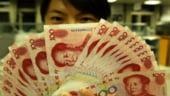 Yuanul chinezesc devine tot mai popular pentru efectuarea de plati