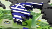 Zona euro va debloca un imprumut vital pentru Grecia