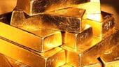 Aurul atinge un nou pret record, de peste 1.123 dolari/uncie