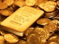 Investitorii incep sa renunte la aur dupa rezolvarea crizei bugetare din SUA